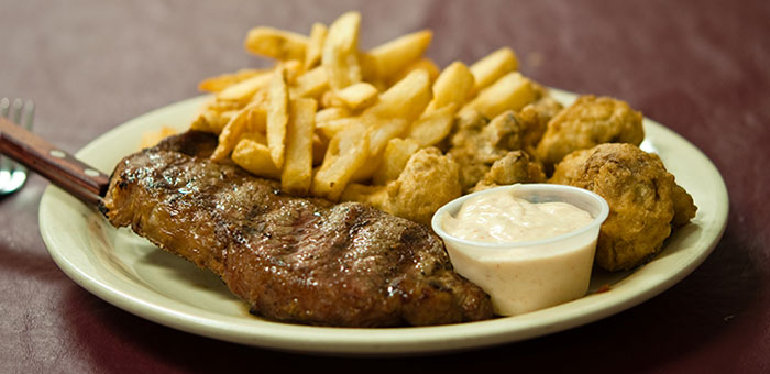 Flat Iron Steak with Fries and fried mushrooms